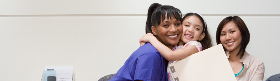 nurse hugging girl